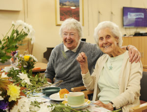 two elderley ladies enjoying flower arranging at the Princes Centre